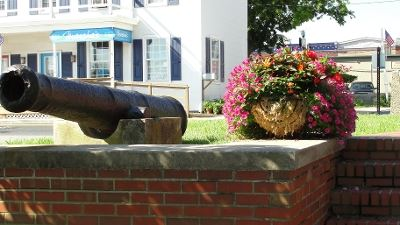 Cannon Memorial Poised over a Brick Wall